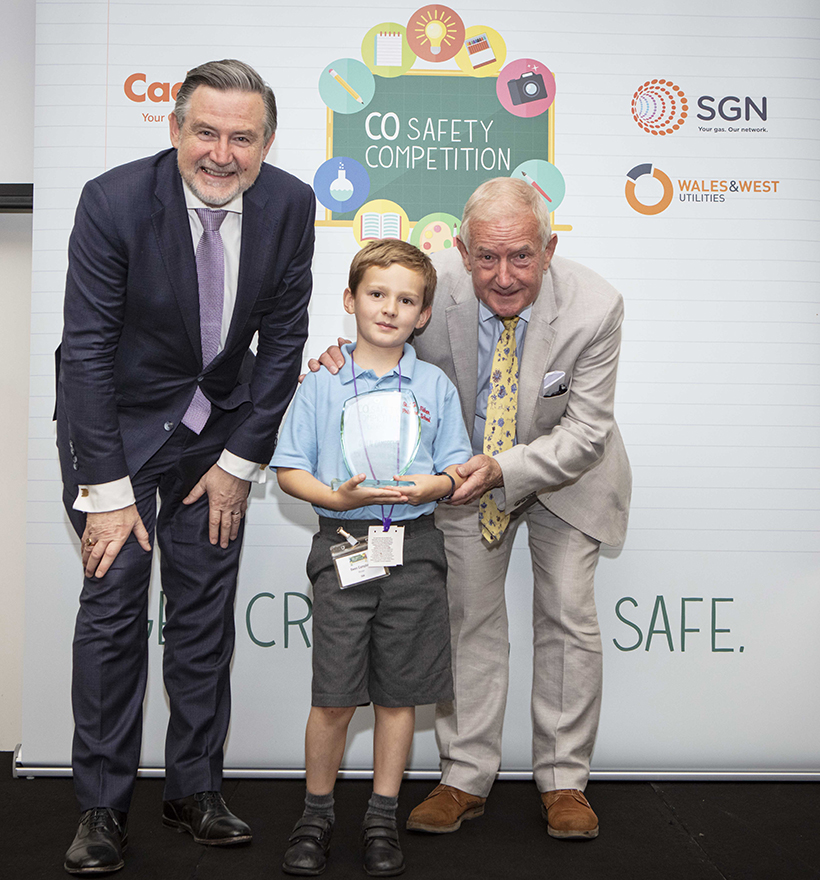 Winning artist Owen Campbell with his award and MPs Barry Gardiner (left) and Barry Sheerman (right).