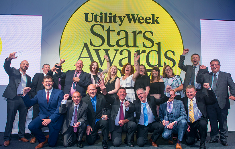 Our celebrates with cheers hands in the air at the Utility Star Awards