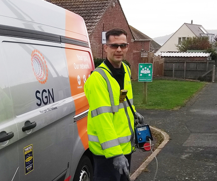 SGN engineer Nathan stands outside his van