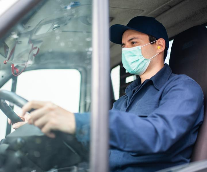 A key worker driving while wearing a mask